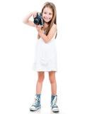 拿着照相机的小女孩 免版税图库摄影