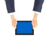 拿着片剂个人计算机的商人手 免版税库存照片