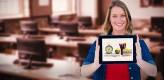 拿着片剂个人计算机的微笑的妇女的综合图象 库存图片