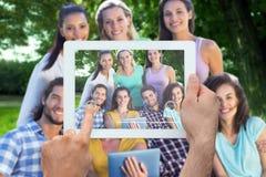 拿着片剂个人计算机的手的综合图象 免版税图库摄影