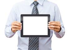 拿着片剂接触计算机小配件的手 库存图片