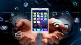 拿着片剂的商人围拢由app和社会象 免版税图库摄影