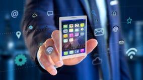 拿着片剂的商人围拢由app和社会象 库存照片