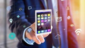 拿着片剂的商人围拢由app和社会象 库存图片