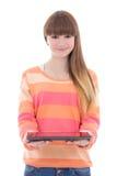 拿着片剂计算机的美丽的十几岁的女孩被隔绝在白色 库存图片