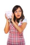 拿着猪金钱箱子的妇女 免版税库存图片