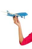拿着玩具飞机的妇女手 库存照片