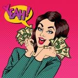 拿着现金的年轻女实业家 有美元的妇女在她的手上 库存照片