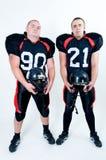 拿着球员的橄榄球盔甲 免版税库存图片