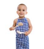 拿着瓢的可爱的儿童厨师 免版税库存照片