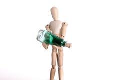 拿着瓶的人 免版税库存照片