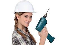 拿着电动工具的建造者 库存照片