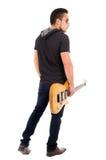 拿着电吉他的年轻人 图库摄影