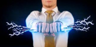 拿着电子供给动力的导线的企业人 免版税库存图片