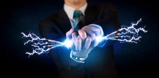 拿着电子供给动力的导线的企业人 库存照片