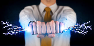 拿着电子供给动力的导线的企业人 库存图片