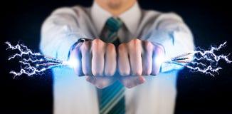 拿着电子供给动力的导线的企业人 图库摄影