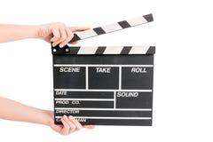 拿着电影生产拍板的妇女 免版税库存照片