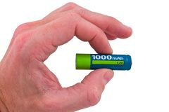 拿着电池的现有量 库存图片