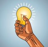 拿着电灯泡的人现有量 免版税库存图片