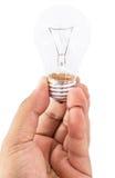拿着电灯泡的男性手 免版税库存照片