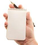 拿着男性填充纸张笔的现有量 免版税库存照片