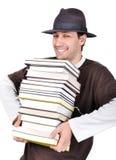 拿着男性年轻人的书 库存图片