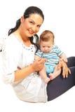 拿着男婴的母亲 免版税图库摄影