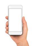 拿着白色智能手机的手 图库摄影