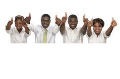 拿着白色标志,赠送阅本空间的四个非洲商人 免版税库存图片