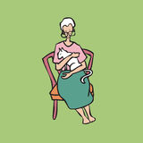拿着白色猫的老妇人 免版税库存照片