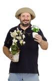 拿着白花罐的有胡子的卖花人 库存图片