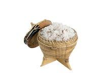 拿着的煮熟的糯米竹容器在白色背景 免版税图库摄影