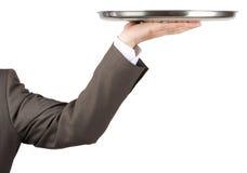 拿着盘子的手 库存图片