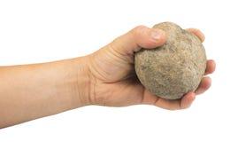 拿着石球的手 免版税库存图片
