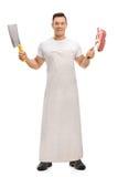 拿着砍肉刀和叉子的屠户 免版税图库摄影