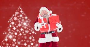 拿着礼物和雪花圣诞树样式的圣诞老人塑造 库存照片