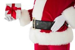 拿着礼物的圣诞老人的中间部分 免版税库存图片