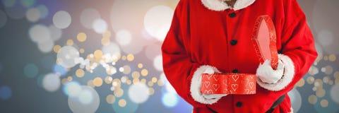 拿着礼物的圣诞老人 库存图片