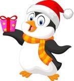 拿着礼物的逗人喜爱的企鹅动画片 免版税库存照片