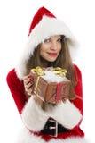 拿着礼物盒的圣诞老人女孩。 免版税库存图片