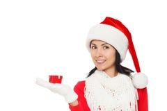 拿着礼物盒的圣诞老人女孩 库存图片