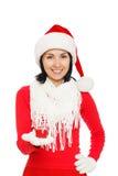 拿着礼物盒的圣诞老人女孩 库存照片