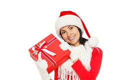 拿着礼物盒的圣诞老人女孩 免版税库存照片
