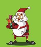 拿着礼物盒的圣诞老人 库存图片