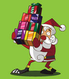 拿着礼物盒的圣诞老人 图库摄影
