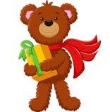 拿着礼物盒的逗人喜爱的熊 免版税库存照片