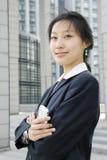 拿着移动电话妇女的商业 免版税库存图片