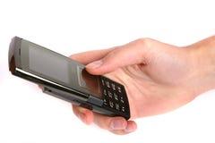 拿着移动电话妇女的现有量 免版税库存图片