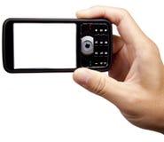 拿着移动电话的照相机 免版税图库摄影